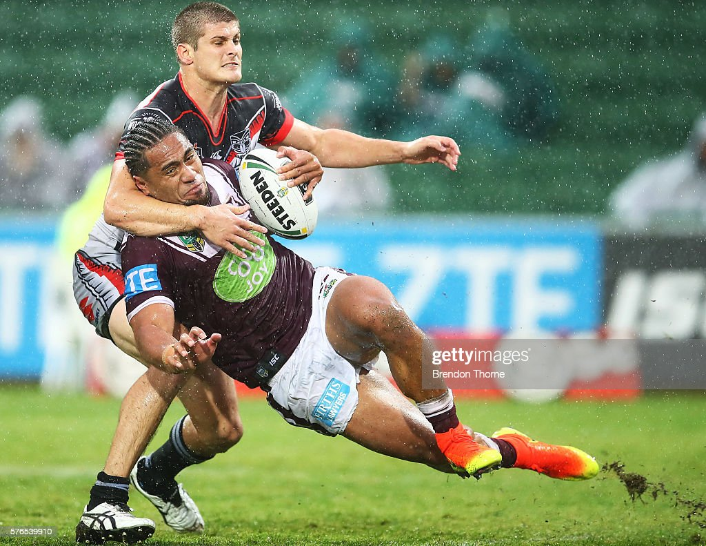 Jorge Taufua of the Sea Eagles is tackled by Blake Ayshford of the Warriors during the round 19 NRL match between the Manly Sea Eagles and the New Zealand Warriors at nib Stadium on July 16, 2016 in Perth, Australia.