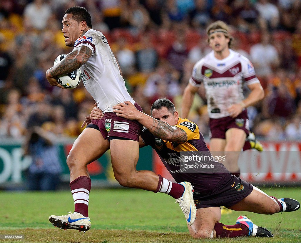 Jorge Taufua of the Sea Eagles is tackled by Corey Parker of the Broncos during the round one NRL match between the Brisbane Broncos and the Manly Warringah Sea Eagles at Suncorp Stadium on March 8, 2013 in Brisbane, Australia.