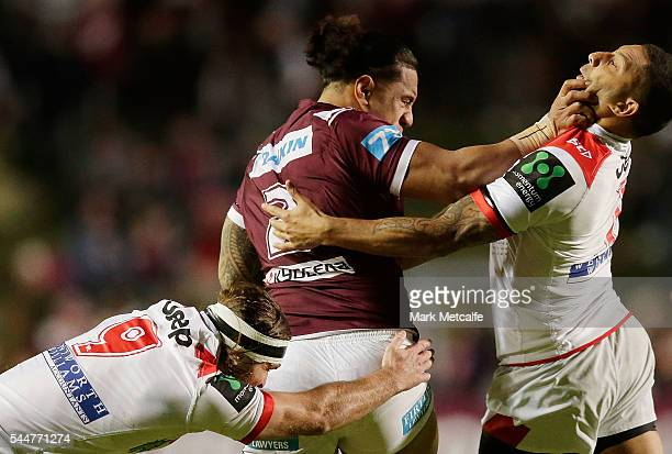 Jorge Taufua of the Sea Eagles is tackled by Mitch Rein and Benji Marshall of the Dragons during the round 17 NRL match between the Manly Sea Eagles...