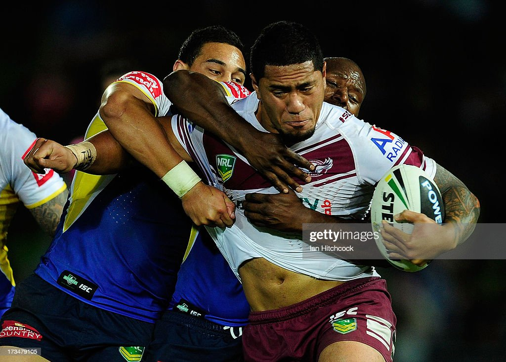 Jorge Taufua of the Sea Eagles is tackled by Robert Lui and Antonio Winterstein of the Cowboys during the round 18 NRL match between the North Queensland Cowboys and the Manly Sea Eagles at 1300SMILES Stadium on July 15, 2013 in Townsville, Australia.
