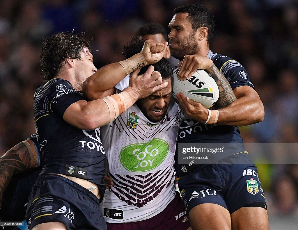 Jorge Taufua of the Sea Eagles is tackled by Rory Kostjasyn and Justin O'Neil of the Cowboys during the round 16 NRL match between the North Queensland Cowboys and the Manly Sea Eagles at 1300SMILES Stadium on June 27, 2016 in Townsville, Australia.