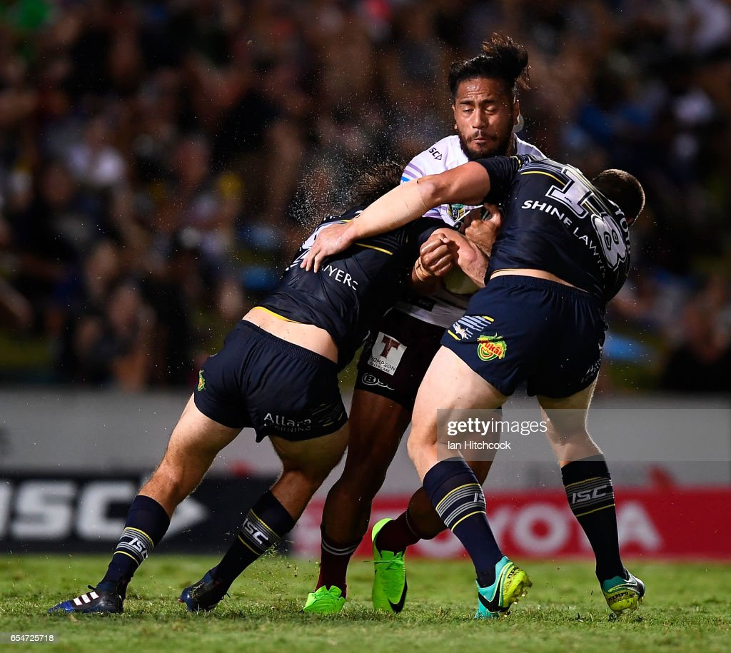 Jorge Taufua of the Sea Eagles is tackled by Shaun Fensom of the Cowboys during the round three NRL match between the North Queensland Cowboys and the Manly Sea Eagles at 1300SMILES Stadium on March 18, 2017 in Townsville, Australia.