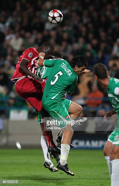 Jorge Teixeira of Maccabi Haifa and Abdou Traore of Bordeaux play the ball during their UEFA Champions League Group A matchday 6 game on December 8...