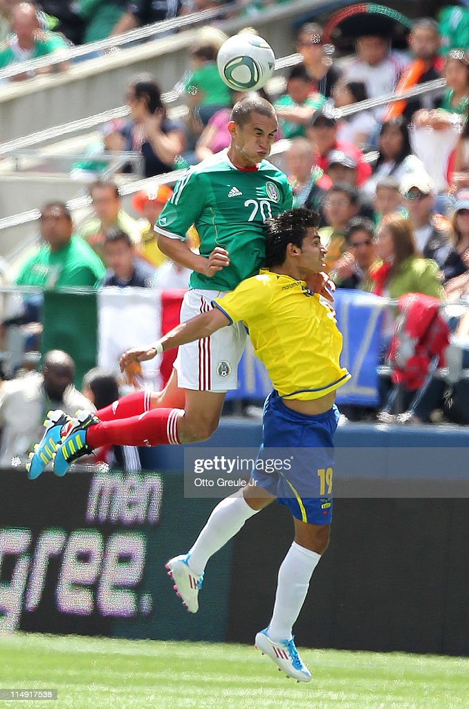 <a gi-track='captionPersonalityLinkClicked' href=/galleries/search?phrase=Jorge+Torres&family=editorial&specificpeople=540782 ng-click='$event.stopPropagation()'>Jorge Torres</a> Nilo #20 of Mexico battles Luis Fernando Saritama #19 of Ecuador at Qwest Field on May 28, 2011 in Seattle, Washington. Mexico and Ecuador played to a 1-1 tie.