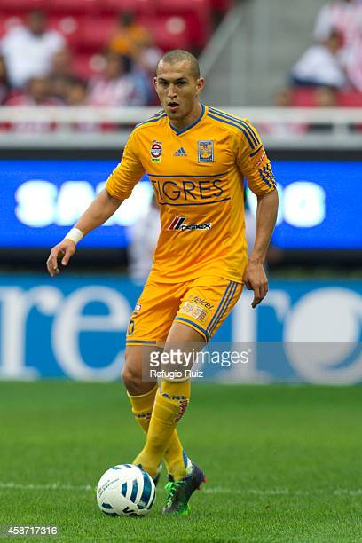 Jorge Torres Nilo of Tigres drives the ball during a match between Chivas and Tigres UANL as part of 16th round Apertura 2014 Liga MX at Omnilife...