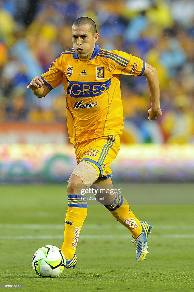 <a gi-track='captionPersonalityLinkClicked' href=/galleries/search?phrase=Jorge+Torres&family=editorial&specificpeople=540782 ng-click='$event.stopPropagation()'>Jorge Torres</a> Nilo of Tigres drives the ball during the match between Tigres and Monterrey as part of the Clausura Tournament 2013 on May 11, 2013 in Monterrey, Mexico.