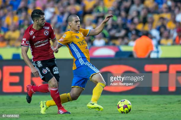 Jorge Torres Nilo of Tigres fights for the ball with Guido Rodriguez of Tijuana during the 16th round match between Tigres UANL and Tijuana as part...