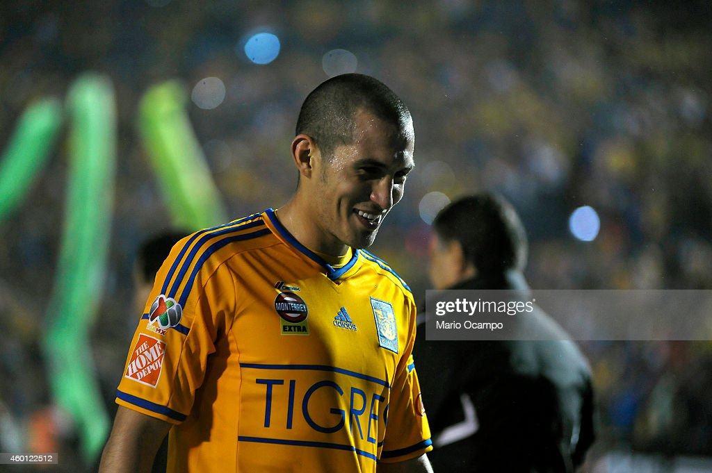 <a gi-track='captionPersonalityLinkClicked' href=/galleries/search?phrase=Jorge+Torres&family=editorial&specificpeople=540782 ng-click='$event.stopPropagation()'>Jorge Torres</a> Nilo of Tigres smiles at the end of a semifinal second leg match between Tigres UANL and Toluca as part of the Apertura 2014 Liga MX at Universitario Stadium on December 07, 2014 in Monterrey, Mexico.