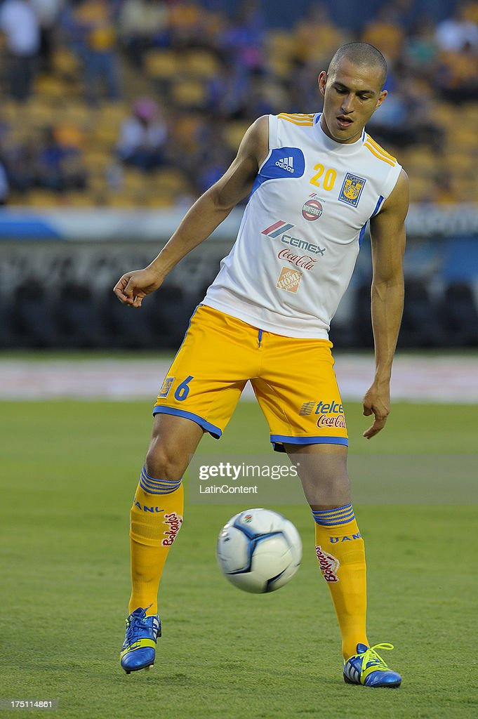 <a gi-track='captionPersonalityLinkClicked' href=/galleries/search?phrase=Jorge+Torres&family=editorial&specificpeople=540782 ng-click='$event.stopPropagation()'>Jorge Torres</a> Nilo of Tigres warms up before a match between Tigres and Morelia as part of Apertura 2013 Tournament, at Universitario stadium, on July 31, 2013 in Monterrey, Mexico.