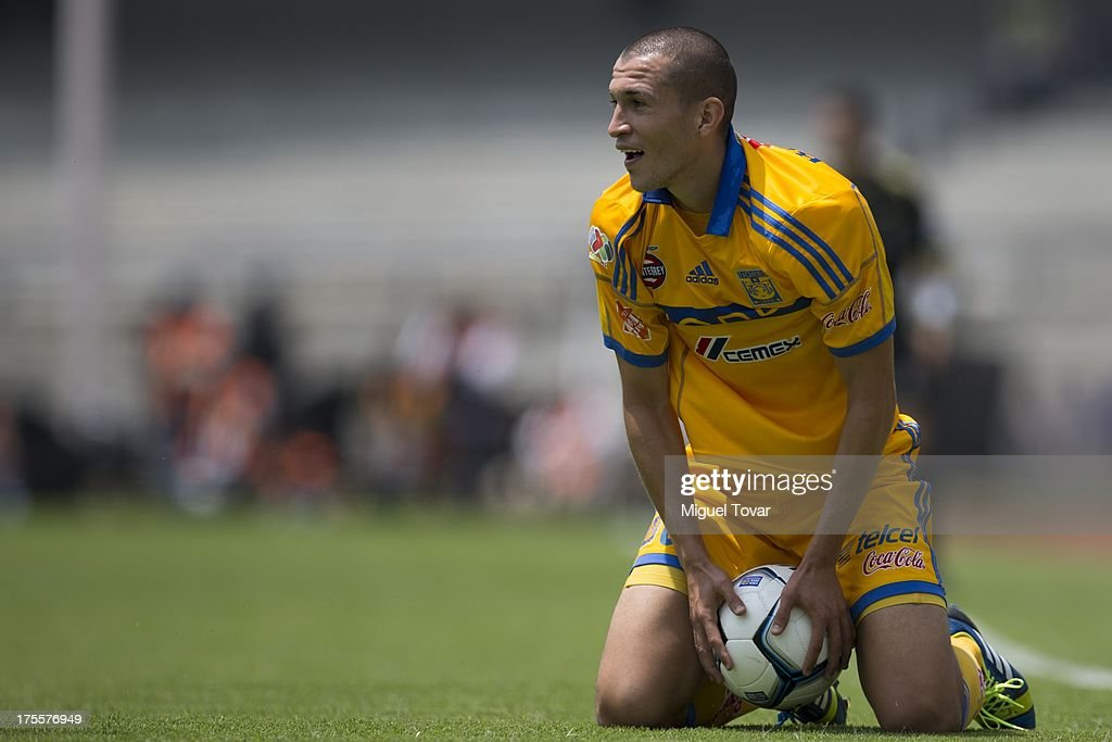 <a gi-track='captionPersonalityLinkClicked' href=/galleries/search?phrase=Jorge+Torres&family=editorial&specificpeople=540782 ng-click='$event.stopPropagation()'>Jorge Torres</a> Nilo reacts during a match between Pumas and Tigres as part of the league MX at Olympic stadium, on August 04, 2013 in Mexico City, Mexico.