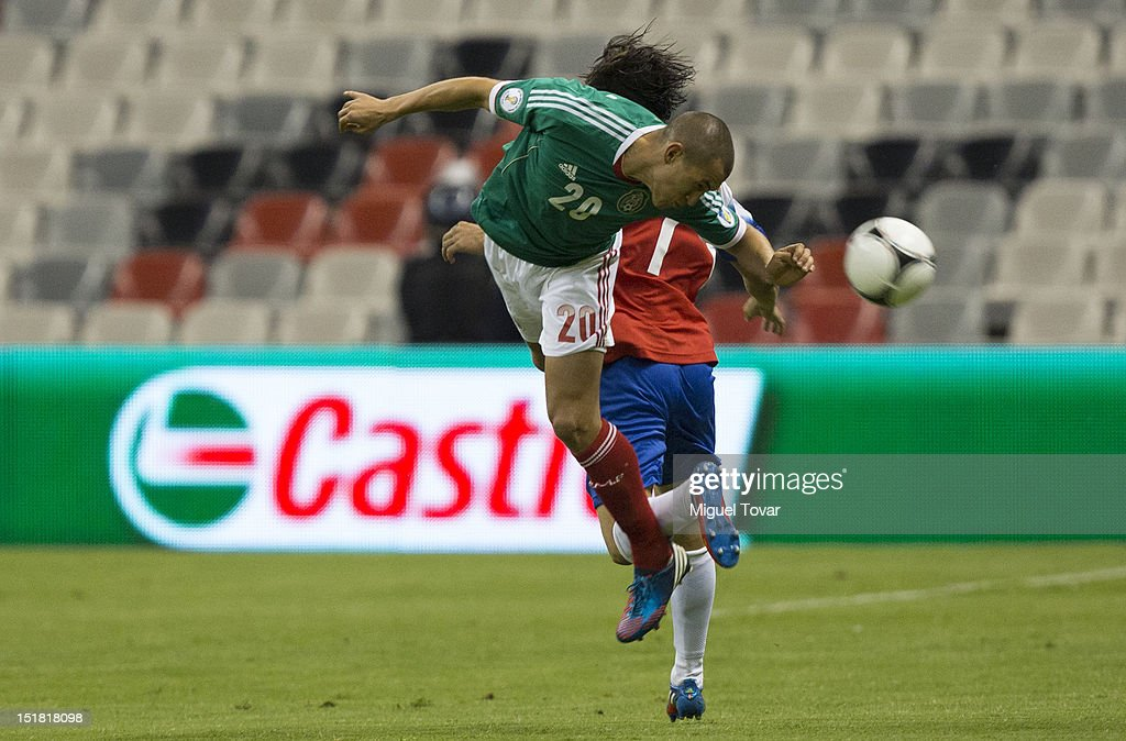 <a gi-track='captionPersonalityLinkClicked' href=/galleries/search?phrase=Jorge+Torres&family=editorial&specificpeople=540782 ng-click='$event.stopPropagation()'>Jorge Torres</a> of Mexico figths for the ball with <a gi-track='captionPersonalityLinkClicked' href=/galleries/search?phrase=Randall+Brenes&family=editorial&specificpeople=2275484 ng-click='$event.stopPropagation()'>Randall Brenes</a> of Costa Rica during a match between Mexico and Costa Rica as part of the CONCACAF Qualifiers for the FIFA Brazil 2014 World Cup at Azteca Stadium on September 11, 2012 in Mexico City, Mexico.