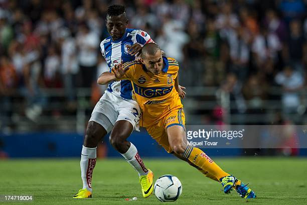 Jorge Torres of Tigres fights for the ball with Duvier Riascos of Pachuca during a match between Pachuca and Tigres as part of the Apertura 2013...