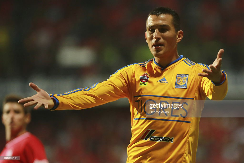 <a gi-track='captionPersonalityLinkClicked' href=/galleries/search?phrase=Jorge+Torres&family=editorial&specificpeople=540782 ng-click='$event.stopPropagation()'>Jorge Torres</a> of Tigres reacts during a match between Toluca and Tigres UANL as part of the 13th round of Clausura 2014 Liga MX at Nemesio Diez Stadium on March 29, 2014 in Toluca, Mexico.