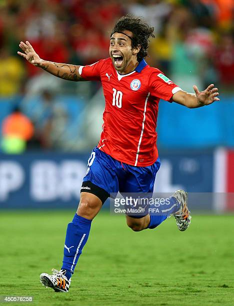 Jorge Valdivia of Chile celebrates after scoring a goal during the 2014 FIFA World Cup Brazil Group B match between Chile and Australia at Arena...