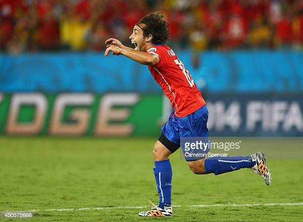 Jorge Valdivia of Chile celebrates after scoring the team's second goal during the 2014 FIFA World Cup Brazil Group B match between Chile and...