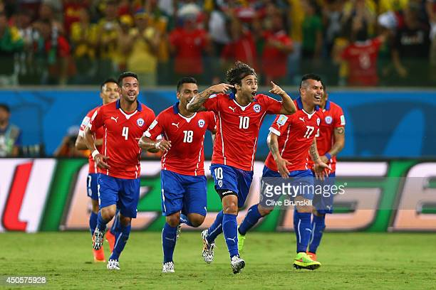 Jorge Valdivia of Chile celebrates scoring the team's second goal with teammates during the 2014 FIFA World Cup Brazil Group B match between Chile...