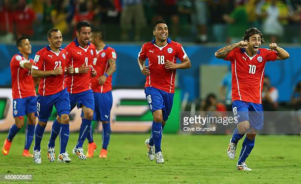 Jorge Valdivia of Chile celebrates with team mates as he scores their second goal during the 2014 FIFA World Cup Brazil Group B match between Chile...