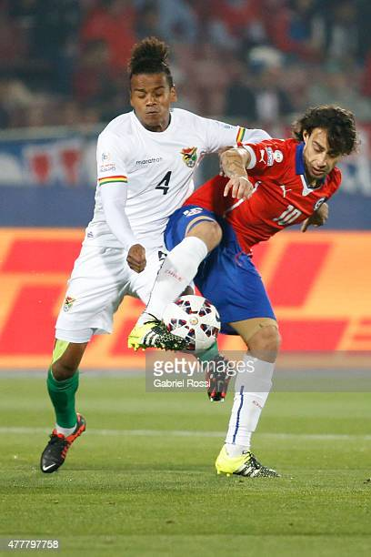 Jorge Valdivia of Chile fights for the ball with Alejandro Pinedo of Bolivia during the 2015 Copa America Chile Group A match between Chile and...