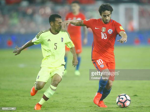 Jorge Valdivia of Chile fights for the ball with Arquimedes Figuera of Venezuela during a match between Chile and Venezuela as part of FIFA 2018...