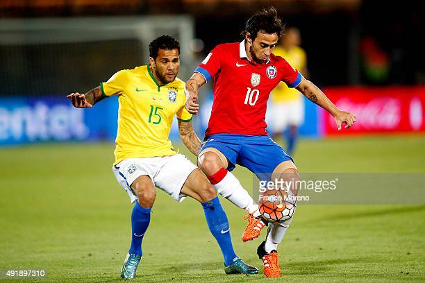 Jorge Valdivia of Chile fights for the ball with Dani Alves of Brasil during a match between Chile and Brasil as part of FIFA 2018 World Cup...