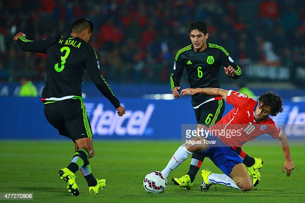 Jorge Valdivia of Chile fights for the ball with Hugo Ayala of Mexico during the 2015 Copa America Chile Group A match between Chile and Mexico at...