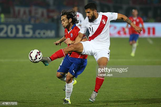 Jorge Valdivia of Chile fights for the ball with Josepmir Ballon of Peru during the 2015 Copa America Chile Semi Final match between Chile and Peru...