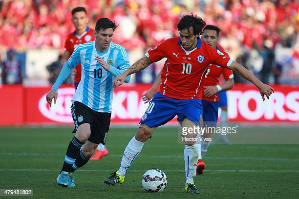 Jorge Valdivia of Chile fights for the ball with Lionel Messi of Argentina during the 2015 Copa America Chile Final match between Chile and Argentina...