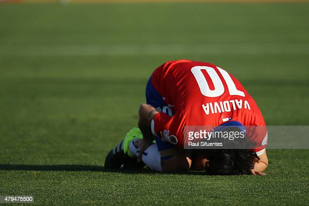 Jorge Valdivia of Chile lies injuried during the 2015 Copa America Chile Final match between Chile and Argentina at Nacional Stadium on July 04 2015...
