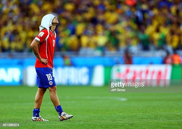 Jorge Valdivia of Chile reacts after being defeated by Brazil in a penalty shootout during the 2014 FIFA World Cup Brazil round of 16 match between...