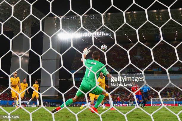 Jorge Valdivia of Chile shoots and scores his team's second goal against goalkeeper Mathew Ryan of Australia during the 2014 FIFA World Cup Brazil...