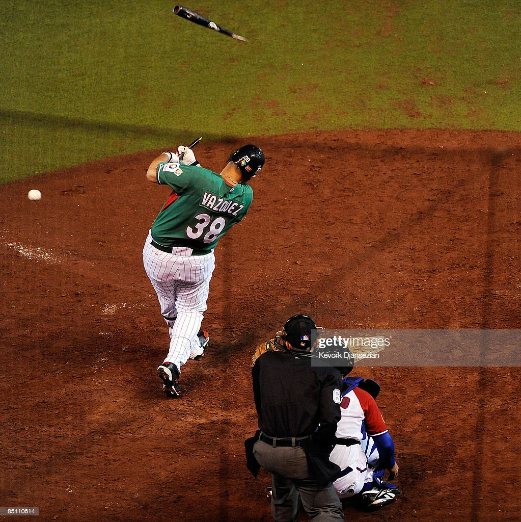 Jorge Vazquez #38 of Mexico breaks his bat against pitcher Yunesky Maya #97 of Cuba during the 2009 World Baseball Classic Pool B match on March 12, 2009 at the Estadio Foro Sol in Mexico City, Mexico. Cuba won, 16-4.