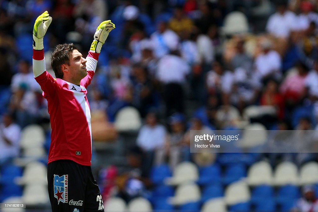 Jorge Villalpando, goalkeeper of Puebla celebrates a goal against Pumas during a match between Pumas and Puebla as part of the Torneo Apertura 2013 Liga Mx at Cuauhtemoc Stadium on July 21, 2013 in Puebla, Mexico.