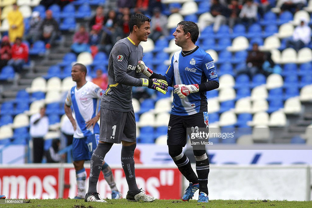 Jorge Villalpando (R) of Puebla greets Alfredo Talavera (L) of Toluca during a match as part of Apertura 2013 Liga MX at Cuauhtemoc Stadium on September 14, 2013 in Puebla, Mexico.