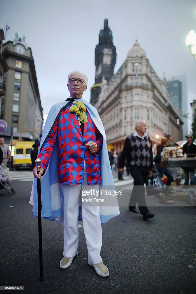 Jorge Williams poses wearing his Argentinian flag in Plaza de Mayo while attending a live broadcast of the inauguration of Pope Francis in Saint Peter's Square on March 19, 2013 in Buenos Aires, Argentina. Francis was the archbishop of Buenos Aires and is the first Pope to hail from Latin America. Celebrants watched in the early morning hours as the event was broadcast at 6:00 a.m. Buenos Aires time.