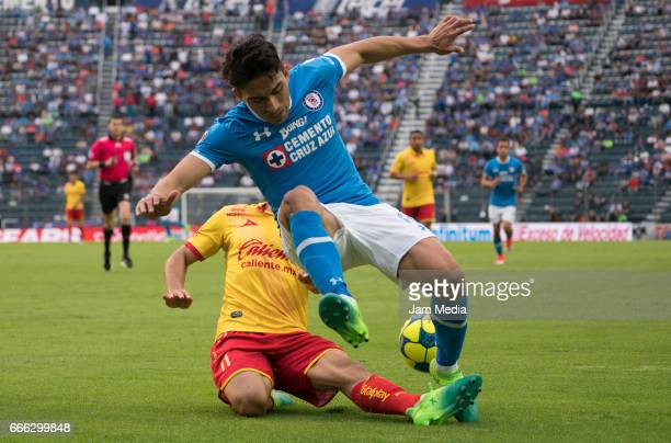 Jorge Zarate of Morelia fights for the ball with Angel Mena of Cruz Azul during the 13th round match between Cruz Azul and Morelia as par of the...