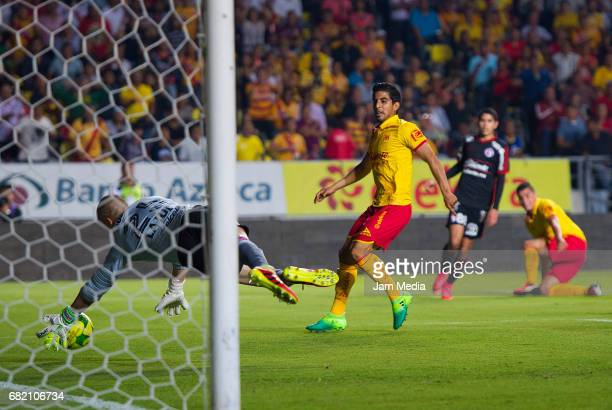 Jorge Zarate of Morelia has a shot on target blocked during the quarter finals first leg match between Morelia and Tijuana as part of the Torneo...