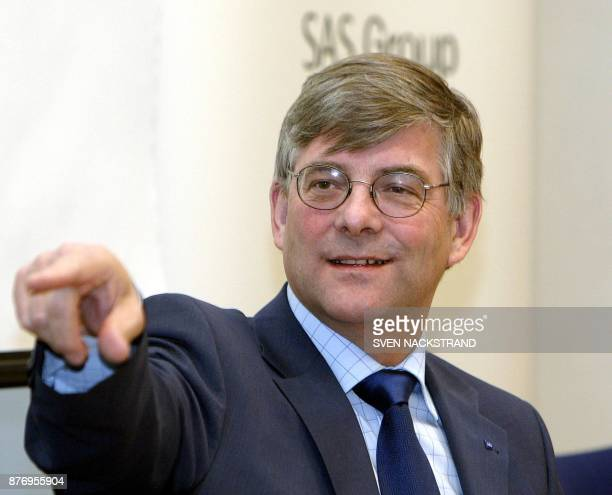 Jorgen Lindegaard CEO of Scandinavian travel conglomerate SAS Group points during the presentation of the fourth quarter report of 2003 at a press...
