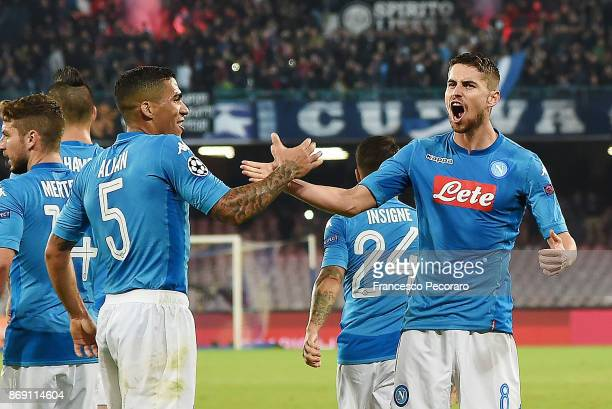 Jorginho and Allan of SSC Napoli celebrate the 22 goal scored by Jorginho during the UEFA Champions League group F match between SSC Napoli and...