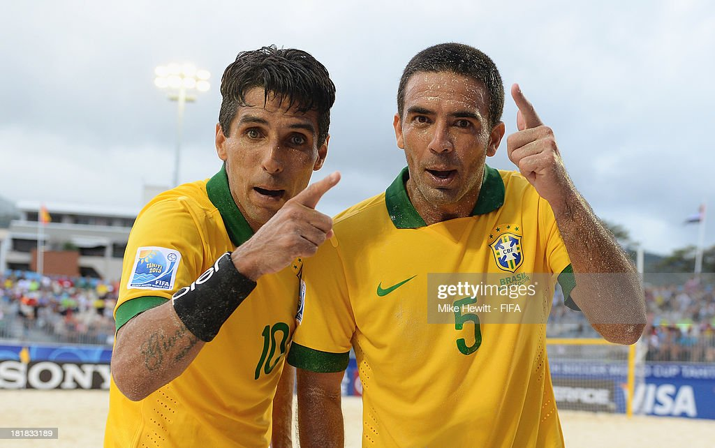Jorginho (L) and Daniel of Brazil celebrate victory at the end of the FIFA Beach Soccer World Cup Tahiti 2013 Quarter Final match between Brazil and Japan at the Tahua To'ata Stadium on September 25, 2013 in Papeete, French Polynesia.