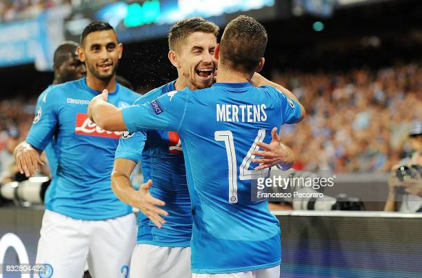 Jorginho and Dries Mertens of SSC Napoli celebrate the 10 goal scored by Dries Mertens during the UEFA Champions League Qualifying PlayOffs Round...