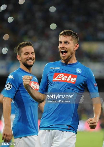 Jorginho and Dries Mertens of SSC Napoli celebrate the 20 goal scored by Jorginho during the UEFA Champions League Qualifying PlayOffs Round First...