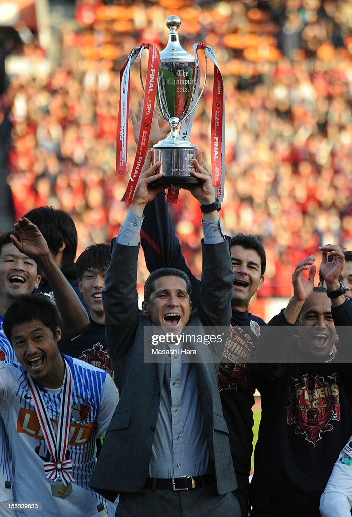 Jorginho, coach of Kashima Antlers lifts the trophy as he celebrates victory after the J.League Yamazaki Nabisco Cup final between Shimizu S-Pulse and Kashima Antlers at the National Staidum on November 3, 2012 in Tokyo, Japan.