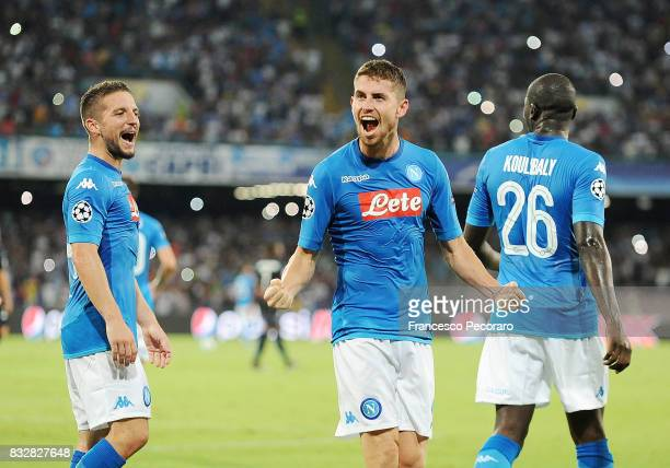 Jorginho Kalidou Koulibaly and Dries Mertens of SSC Napoli celebrate the 20 goal scored by Jorginho during the UEFA Champions League Qualifying...
