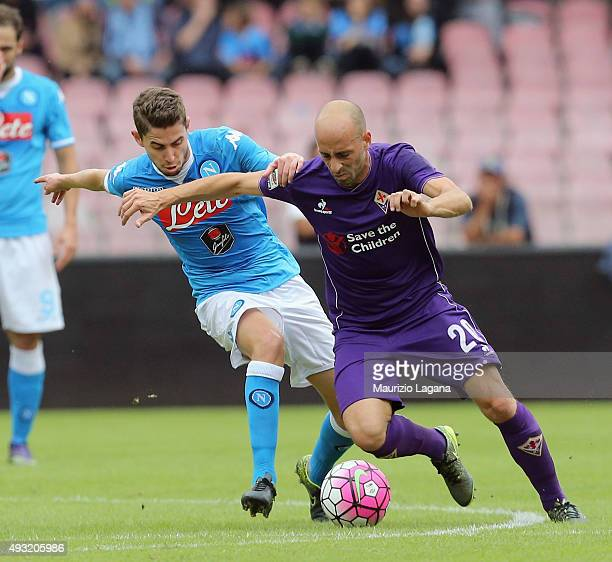 Jorginho of Napoli competes for the ball with Borja Valero of Fiorentina during the Serie A match between SSC Napoli and ACF Fiorentina at Stadio San...