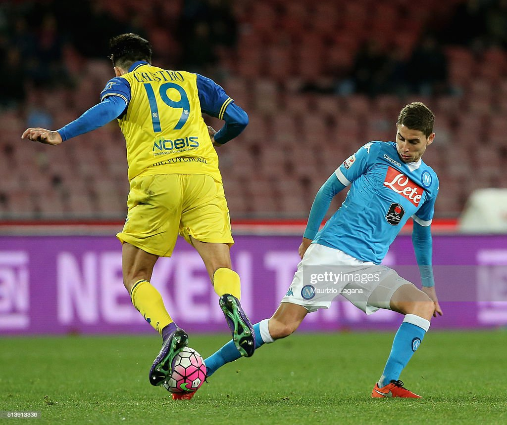 Jorginho of Napoli competes for the ball with Lucas Castro of Chievo during the Serie A match between SSC Napoli and AC Chievo Verona at Stadio San...