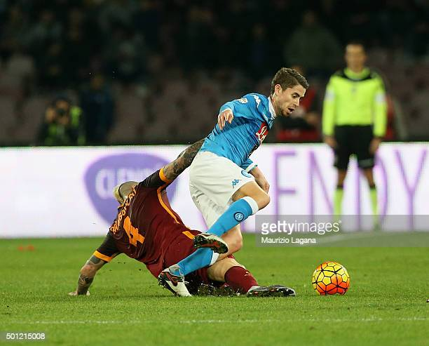 Jorginho of Napoli competes for the ball with Radja Nainggolan of Roma during the Serie A match betweeen SSC Napoli and AS Roma at Stadio San Paolo...