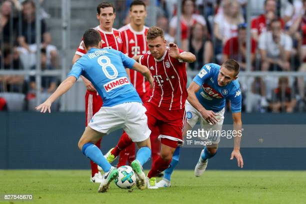Jorginho of Neapel Marko Rog of Neapel and Joshua Kimmich of Bayern Muenchen battle for the ball during the Audi Cup 2017 match between SSC Napoli...