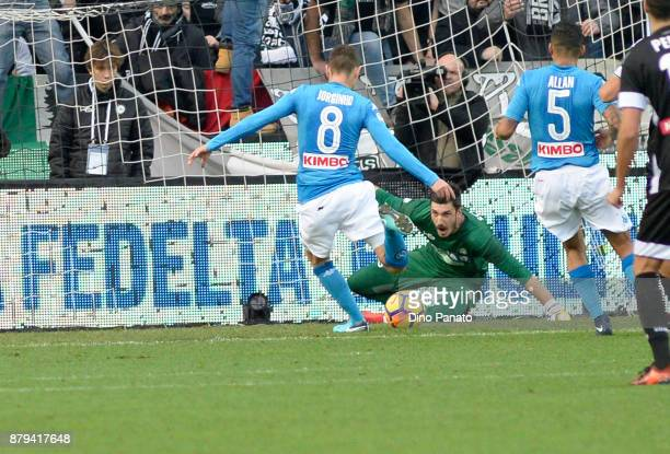 Jorginho of SSC Napoli scores his opening goal after misses a penalty spot during the Serie A match between Udinese Calcio and SSC Napoli at Stadio...
