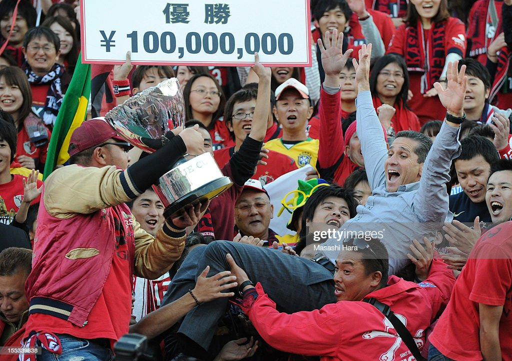 Jorginho,coach of Kashima Antlers celebrates with the supporters after the J.League Yamazaki Nabisco Cup final between Shimizu S-Pulse and Kashima Antlers at the National Staidum on November 3, 2012 in Tokyo, Japan.