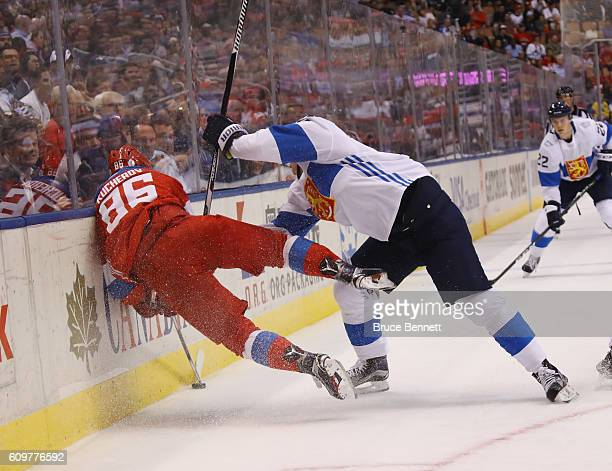 Jori Lehtera of Team Finland hits Nikita Kucherov of Team Russia into the boards during the second period during the World Cup of Hockey tournament...
